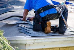 Man repairs Cartersville, GA roof.